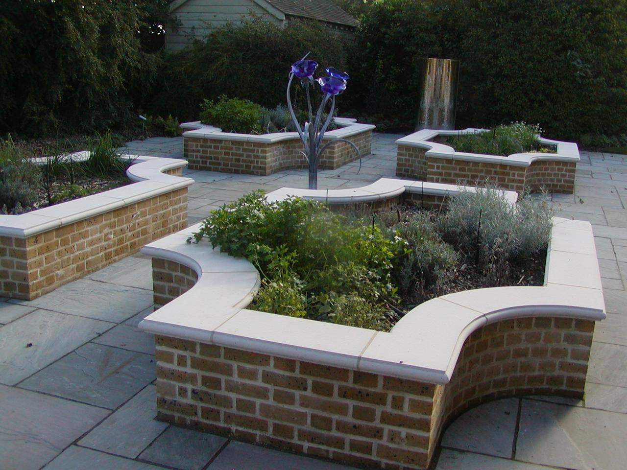 Decorative Raised Planting Beds With Stone Capping Garden Walls ...